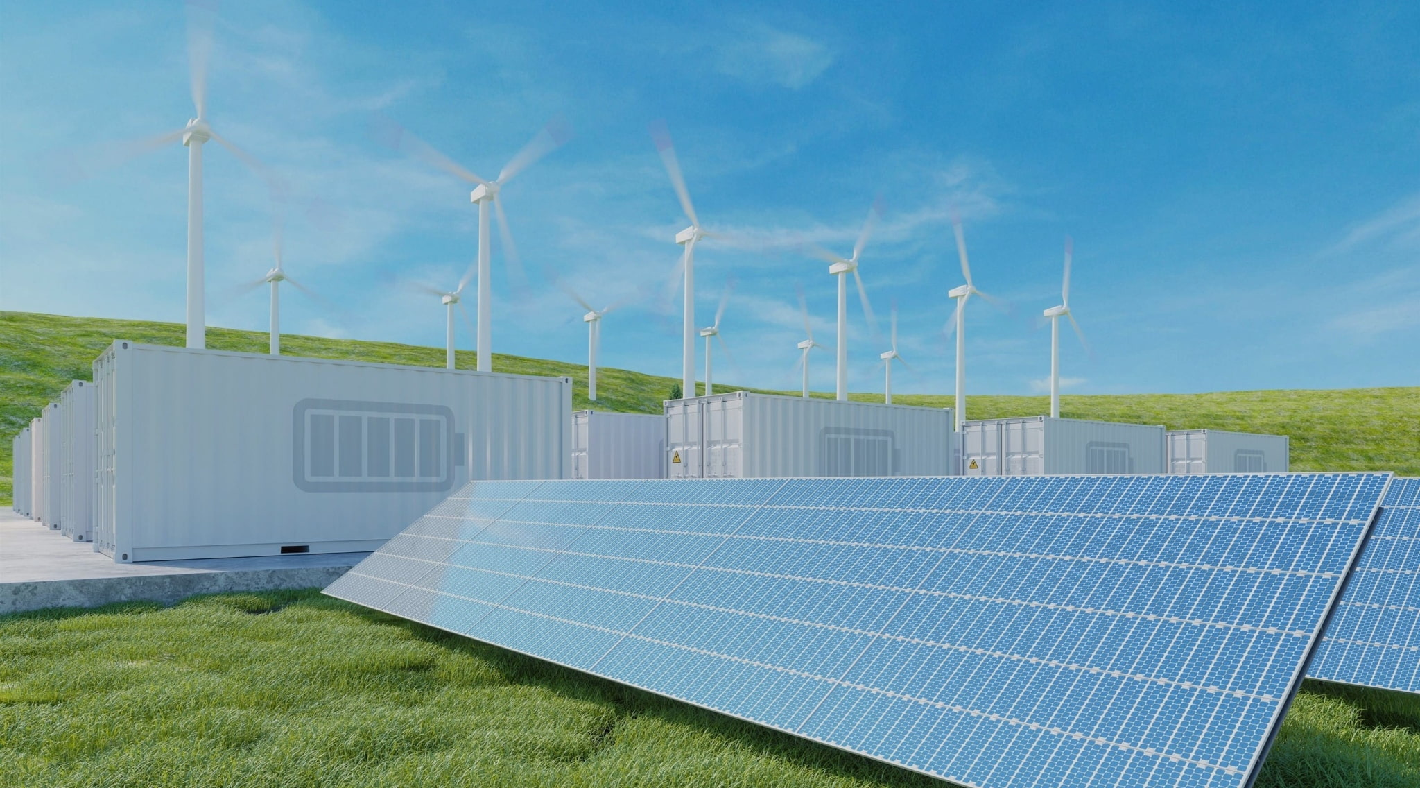 Solar panels, wind turbines and battery storages at the field